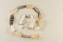 e-mail symbol made of seashells - stock photo