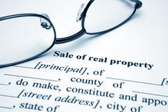 sale of real property - stock photo