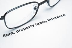 rent, property taxes, insurance - stock photo
