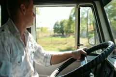 Truck Driver at the Wheel Stock Footage