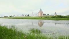 Saviour Prilutskyl Monastery on coast of river with water lilly Stock Footage