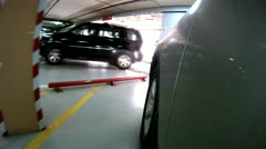 Car leaves underground garage in which there are other cars Stock Footage