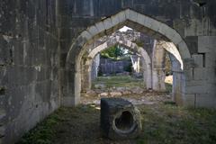 Beautiful oriental arches in medival caravanserai Stock Photos