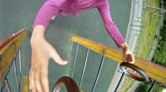 Little girl hang on sports rings at playground Stock Footage