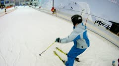 Teenager goes on skis from mountain in ski complex Stock Footage