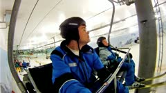 Father with son go on skilift in yearround ski complex Stock Footage