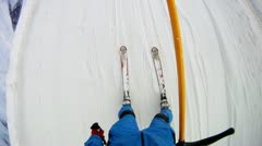Man in ski suit goes on skis on mountain slope Stock Footage