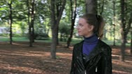 Stock Video Footage of Beautiful young woman walking. Steadycam shot