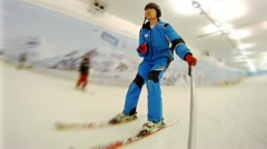 Man goes on skis on mountain slope in ski complex Stock Footage