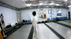 Fencer train in hall, on Moscow city organization Stock Footage