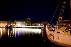 Zadar bridge and a ship at night - stock photo