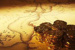 treasure map and doubloons - stock photo