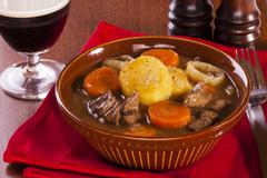 Irish stew and a glass of stout Stock Photos
