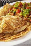 crepes pancakes with ratatouille - stock photo