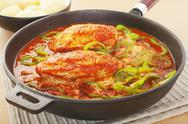 Stock Photo of chicken paprika stew in a cast iron skillet