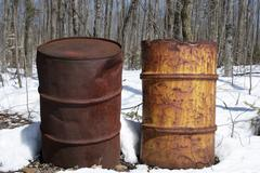 Two rusty iron barrels - stock photo