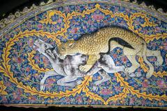 leopard hunt on mosaic arch - stock photo