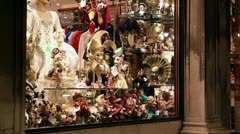 A brightly illuminated window of a souvenir shop in Venice, Italy Stock Footage