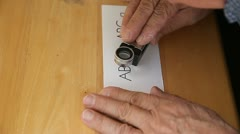 Letterpress printer checks work with magnifier Stock Footage