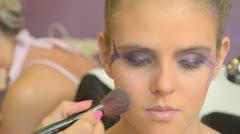 Model putting makeup - stock footage