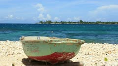Old boat on tropical beach Stock Footage