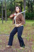 beautiful martial artist outdoors (6) - stock photo