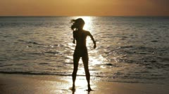mysterious silhouette sexy girl at beach during sunset - stock footage