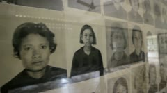 Tortured and Murdered victims pictures in s21 genocide prison - stock footage