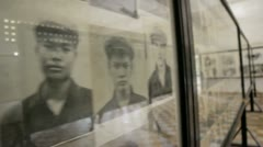 Tortured and Murdered victims pictures in s21 genocide prison Stock Footage