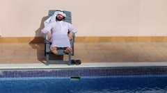 Saudi arabian man enjoying at swimming pool Stock Footage