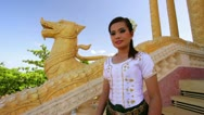 Asian Girl Greets in temple traditional way with both hands Stock Footage