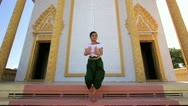 Beautiful Asian Girl performs cambodian folk dance in temple Stock Footage