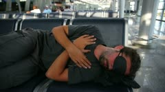 Sleeping in airport with eye cover Stock Footage