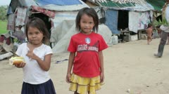 Cambodian kids in slums near phnom penh city dumping area Stock Footage