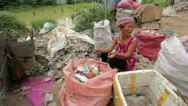 Garbage gatherers assorting trashes in slums Stock Footage