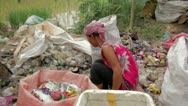 Stock Video Footage of Garbage gatherers assorting trashes in slums
