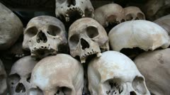 Skulls and bones in Killing field, cambodia, moving camera Stock Footage