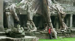 Backpacker travels exotic preah khan temple, angkor, cambodia Stock Footage
