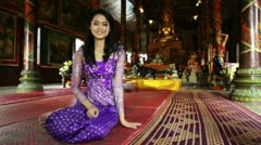 Asian girl praying in temple, wat, pagoda, Phnom Penh, Cambodia Stock Footage