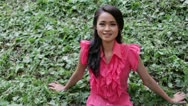 Sexy erotic asian girl with mini skirt on green grass Stock Footage