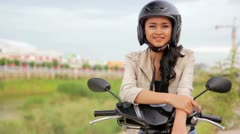 Sexy asian girl with mini skirt, helmet, motorcycle in cambodia Stock Footage
