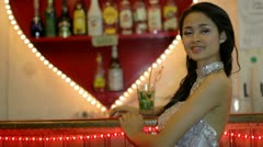 Gorgeous asian woman alone at bar Stock Footage