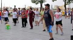 PHNOM PENH - JUNE 2012: outdoor tai chi in city center - stock footage