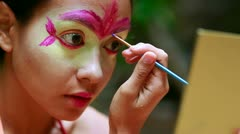 Stock Video Footage of Borneo Rainforest Tribal Culture: Face Painting