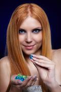 redhead girl with gel balls - stock photo