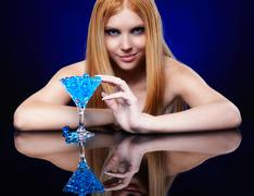 beautiful redhead girl  with gel balls - stock photo