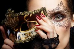 Gorgeous woman in mask Stock Photos