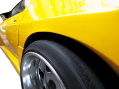 yellow racing car - stock photo