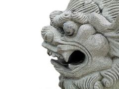 dragon head stone statue - stock photo
