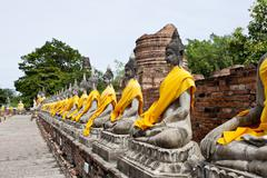 row of buddha image in wat yai chai mongkol, ayutthaya, thailand - stock photo